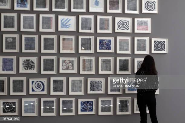 A woman looks at Je taime a series of 60 doublesided drawings by Louise Bourgeois at Glenstone museum in Potomac Maryland on May 8 2018 There's...