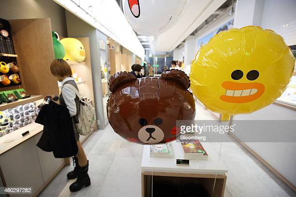 A woman looks at Line Corp character merchandise on display at the Line Friends Store in Tokyo Japan on Thursday Dec 10 2014 Line which makes money...