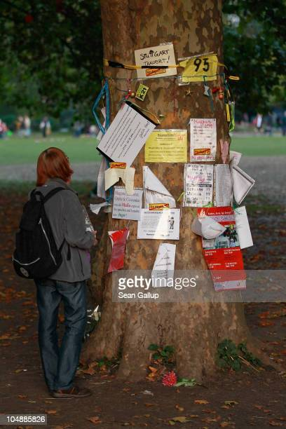 A woman looks at messages attached to one of the nearly 300 trees slated for removal in the Schlosspark next to Hauptbahnhof train station on October...