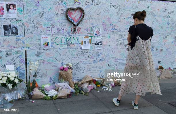 A woman looks at messages on a wall of condolence outside Latymer Community Church on June 16 2017 in London England 17 people have been confirmed...