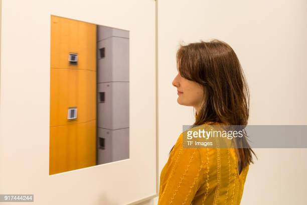 A woman looks at 'Mobile No3' by Andreas Gursky in the reopened Hayward Gallery on January 24 2018 in London England