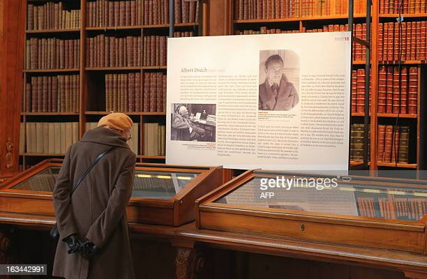 A woman looks at original World War II documents of AustrianJewish writer and lawyer Albert Drach as part of the Nacht Uber Oesterreich exhibtion...