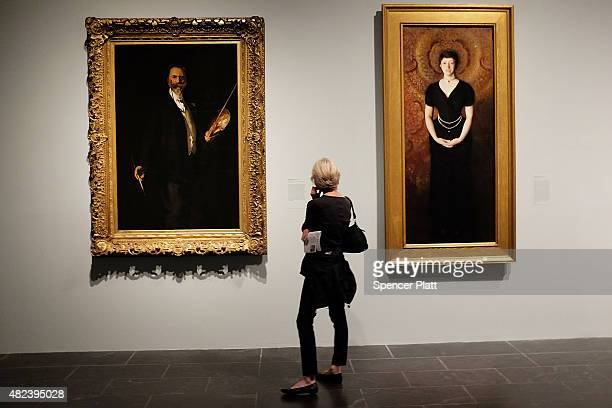 A woman looks at paintings at the Metropolitan Museum of Art on July 30 2015 in New York City The Met recently announced that it drew 63 million...