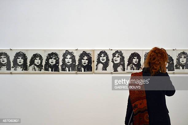 A woman looks at pictures by Katharina Sieverding Maton as part of the exhibition Anni 70 Arte a Roma during a press preview at the Palazzo delle...