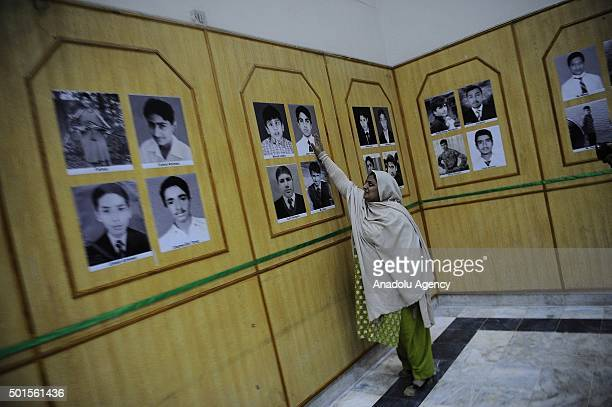 A woman looks at pictures who were amongst the students of Army Public School killed by Taliban militants in a gallery dedicated by the provincial...