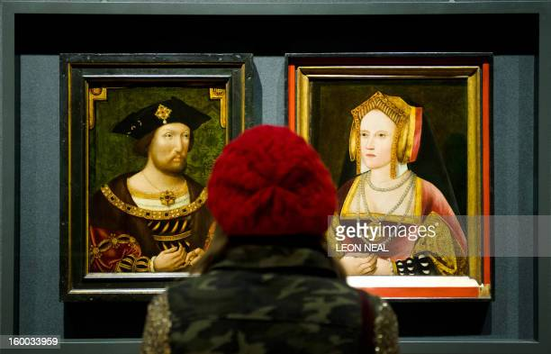 A woman looks at portraits of English King Henry VIII and his first wife Catherine of Aragon displayed together for the first time in nearly 500...