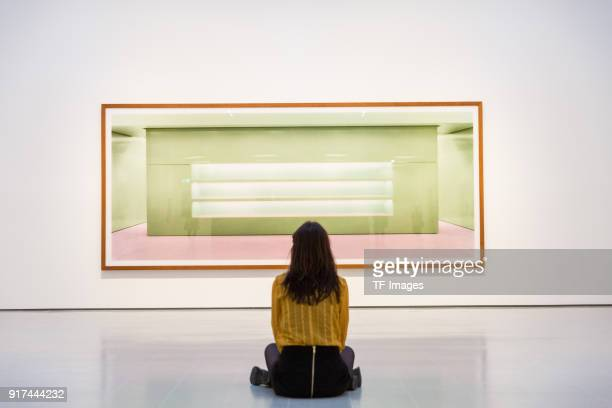 A woman looks at 'Prada II' by Andreas Gursky in the reopened Hayward Gallery on January 24 2018 in London England