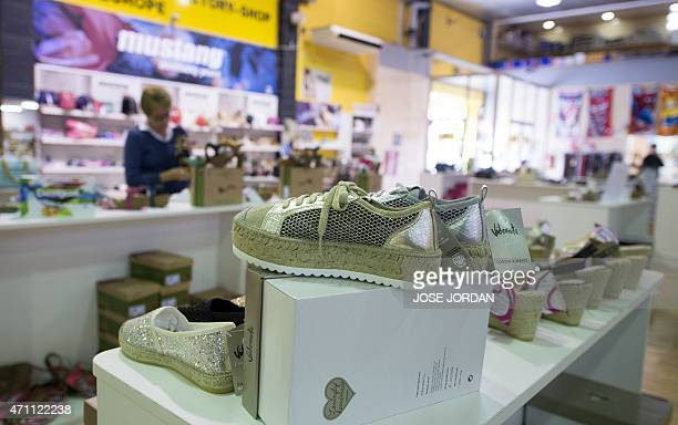 FILLON A woman looks at shoe displays at Salvador Artesano shoe factory in Elche on April 10 2015 'Made in Spain' shoes are doing well but is thanks...
