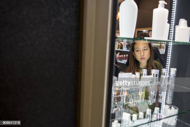 Woman looks at skin care products during the Cosme Tokyo 2018, January 24, 2018 in Japan. Cosme Tokyo 2018 and the Asia's leading exhibition...