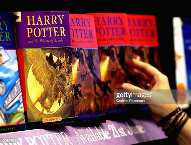 A woman looks at some of JK Rowlings Harry Potter books in waterstones book store on June 16 2003 inLondon Countdown to the launch of the 5th Harry...