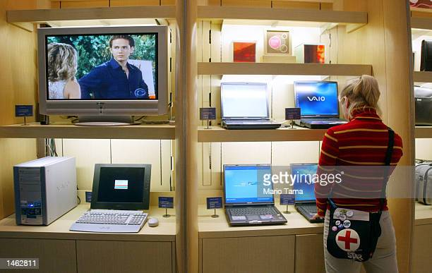 Woman looks at Sony VAIO notebook PC's on sale in The Sony Store October 7, 2002 in New York City. Sony introduced the new VAIO PCV-W10 PC, Sony's...