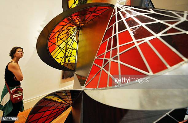 A woman looks at Swiss artist Johannes Itten's 'Tower of Fire' at the 'Bauhaus A Conceptual Model' exhibition in Berlin on July 23 2009 The...