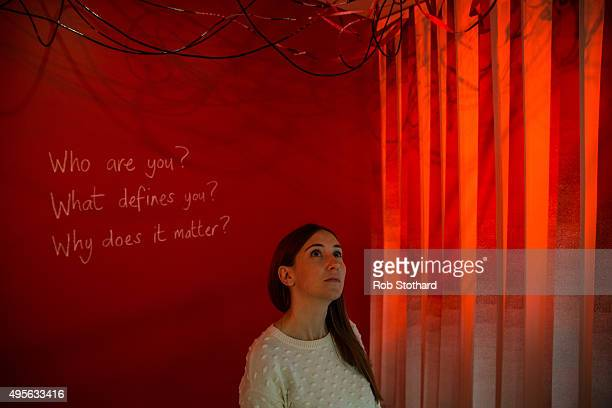 A woman looks at 'Tay Sachs 12' an installation by Tom Piper part of the 'Blood' exhibition at Jewish Museum London on November 4 2015 in London...