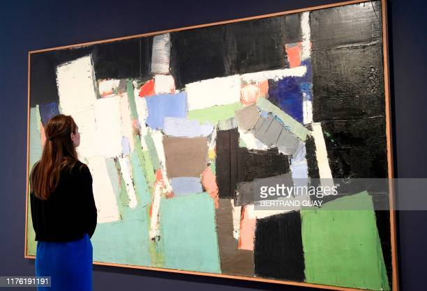 A woman looks at the 1952's painting oil on canvas Parc des Princes by Nicolas De Stael at the Christie's France headquater in Paris on October 16...