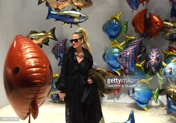 A woman looks at the art of Philippe Parreno titled 'My Room Is Another Fish Bowl' at Christie's New York November 15 2017 / AFP PHOTO / TIMOTHY A...