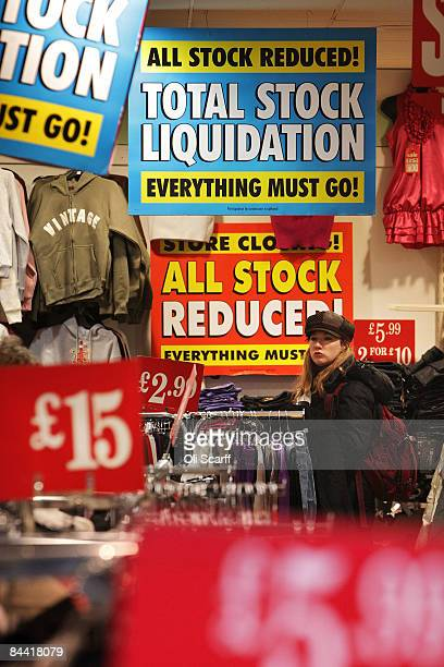 A woman looks at the clothes for sale in a shop advertising a closing down sale on Oxford Street on January 23 2009 in London England Figures...