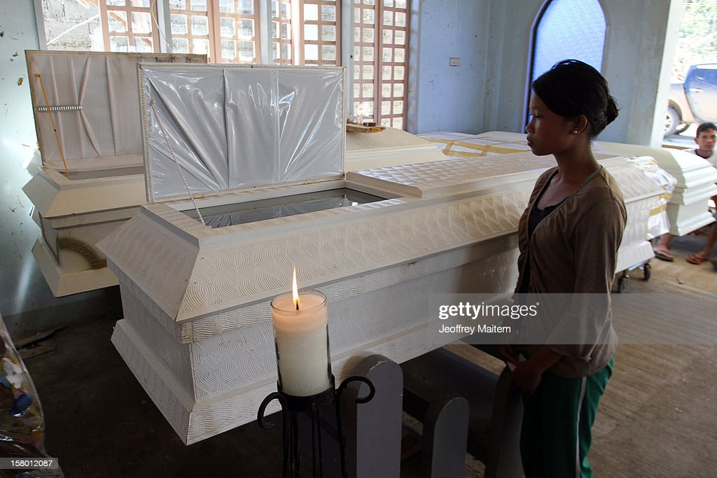 A woman looks at the coffin of a dead relative after Typhoon Bopha on December 8, 2012 in the town of Cateel, Davao Oriental province, Philippines. More than 500 people have been killed and scores of others remain missing after Typhoon Bopha, the strongest storm to hit the Philippines this year, pounded the region. The United Nations Office for the Coordination of Humanitarian Affairs reported that about 5.3 million people are affected and 533 are missing.