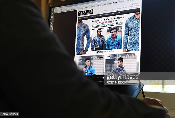 A woman looks at the homepage of the clothing house Barabas which features a photo of Mexican drug lord Joaquín Guzmán Loera 'El Chapo' January 12...