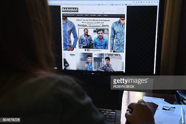 A woman looks at the homepage of the clothing house Barabas which features a photo of Mexican drug lord Joaquín Guzmán Loera El Chapo January 12 2016...