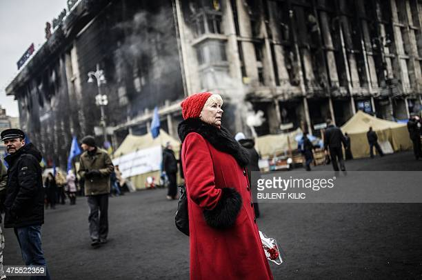 A woman looks at the Independence square in central Kiev on February 28 2014 Ukraine's parliament on Thursday approved the nomination of proEU...