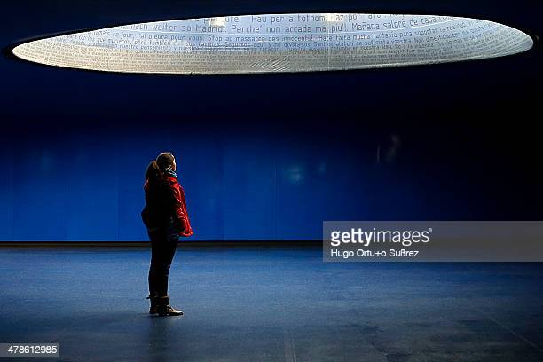 A woman looks at the inside of the glass element of the memorial to the victims of 11M in Madrid The terrorist attack in Atocha claimed the lives of...