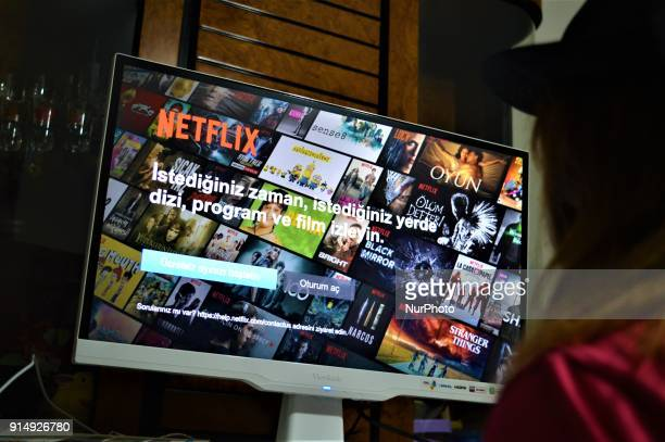 A woman looks at the login screen of online streaming service Netflix in Ankara Turkey on February 5 2018 as an omnibus bill introduced to the...