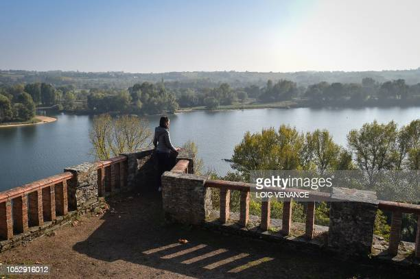A woman looks at the Loire river from Les Folies Siffait site in Le Cellier outside Nantes western France on October 19 2018 This monument which...