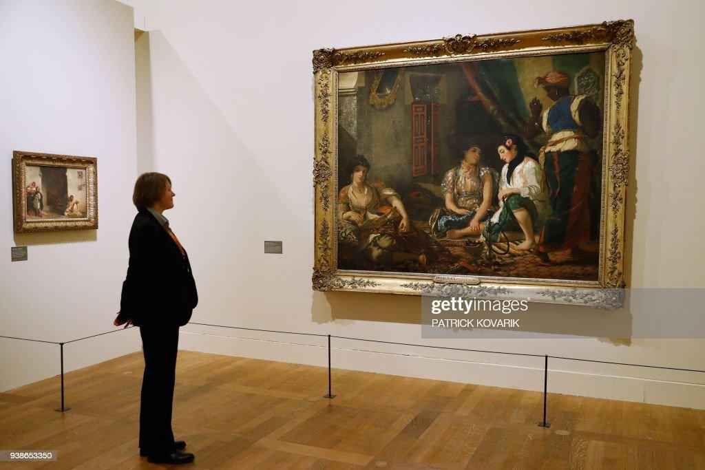 A Woman Looks At The Painting Femmes Dalger Dans Leur