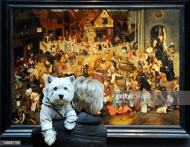 A woman looks at the painting The Battle between Carnival and Lent by Dutch painter Pieter Brueghel II valued at between million and 6 million...