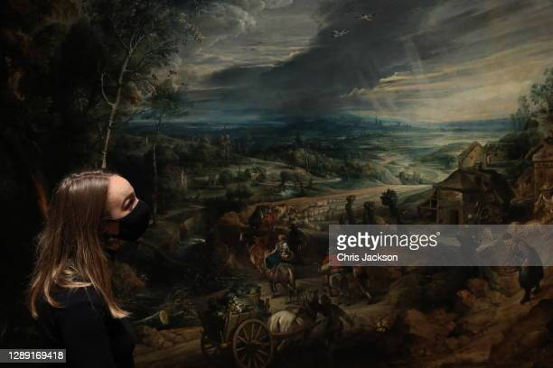 """Woman looks at the Peter Paul Rubens painting 'Summer Peasants Going to Market' during the """"Masterpieces"""" exhibition photocall at The Queen's..."""