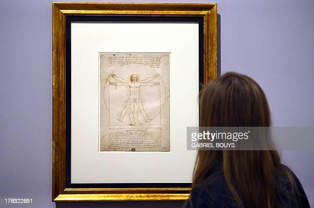 A woman looks at the 'Vitruvian Man' a drawing by Leonardo da Vinci on August 2ç 2013 in Venice Fiftytwo drawings by Renaissance genius Leonardo da...