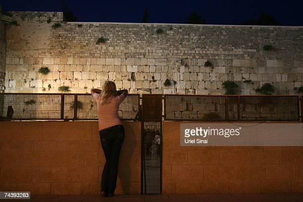 A woman looks at the Western wall in Jerusalems old city on June 4 2007 in Israel Palestinians will mark 40 years of Israeli occupation in Gaza and...