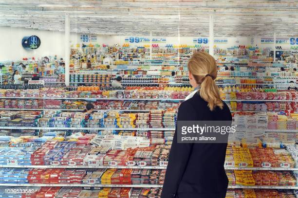 A woman looks at the work '99 Cent' by artist Andreas Gursky at Museum Frieder Burda in BadenBaden Germany 02 October 2015 The art work is part of...