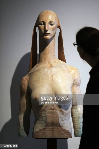 A woman looks at the work 'A tale of the Sphinx'  by Japanese artist Katsure Funakoshi at the museum in Wiesbaden Germany 06 May 2013 After almost...