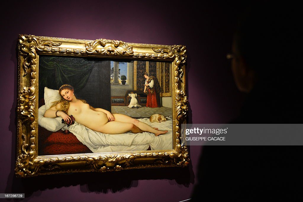 A woman looks at Titian's 'Venus of Urbino' on April 23, 2013 in Venice, during the 'Manet Return to Venice' exhibition, which runs until 18 August 2013, at the Doge's Palace in Venice. Edouard Manet's 'Olympia' will be appearing alongside the a masterpice of Renaissance and source of ispiration for the French artist.