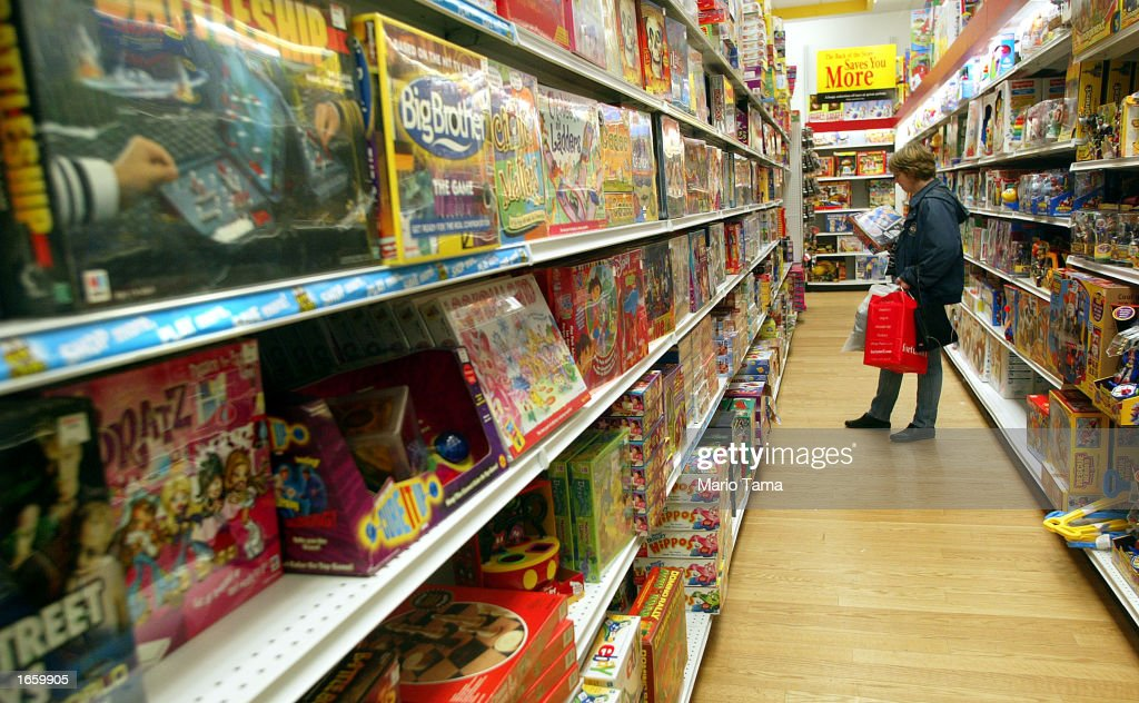 A Woman Looks At Toys In The Kb Toys Store November 25, 2002 In News Photo  Getty -5410