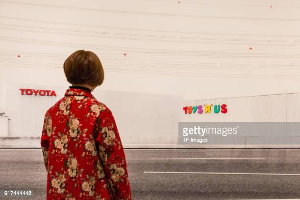 A woman looks at 'Toys R Us' by Andreas Gursky in the reopened Hayward Gallery on January 24 2018 in London England