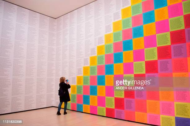 A woman looks at US artist Jenny Holzer's 'Inflammatory Wall' during a presentation of the 'Jenny Holzer Thing Indescribable' exhibition at the...