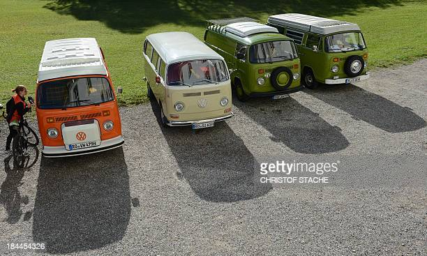 A woman looks at vintage Volkswagen buses during an autumn rally of socalled 'Bulli' enthousiasts in front of the abbey Schaeftlarn near Munich...