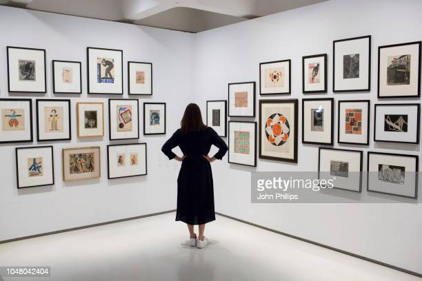 A woman looks at works on display during the Modern Couples Art Intimacy and the Avantgarde press view at the Barbican Art Gallery on October 9 2018...