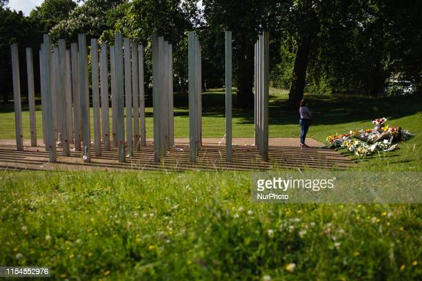 A woman looks at wreaths and flowers of condolence marking 14 years to the day since the 7/7 bombings at the 7 July Memorial in Hyde Park in London...