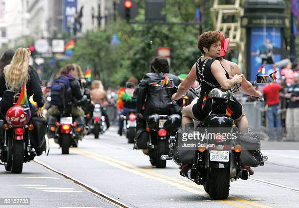 """Woman looks back as she rides with the group """"Dykes on Bikes"""" during the 2005 San Francisco Pride Parade June 26, 2005 in San Francisco, California...."""