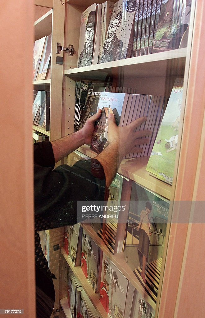 A woman looks displays books on the eve