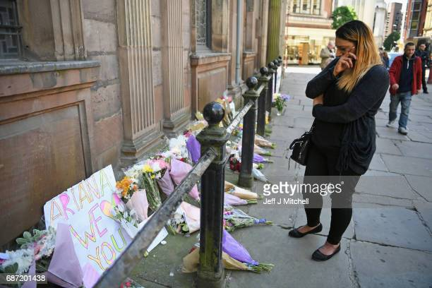 A woman looks emotional as she looks at flowers left in St Ann Square on Tuesday May 23 2017 in ManchesterEngland At least 22 people were killed in a...