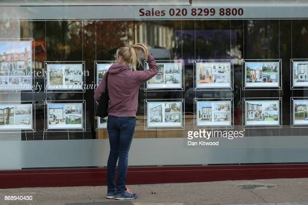 A woman looks in an Estate Agent window on November 1 2017 in London England Ahead of an expected interest rate rise the ratings agency Moody's has...