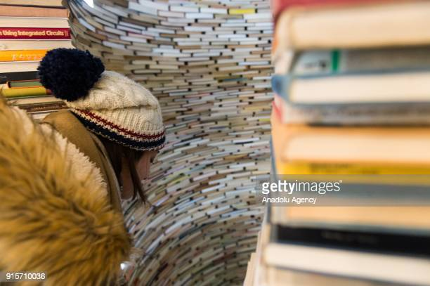 Woman looks inside of Idiom installation, created by Slovakian artist, Matej Kren at Prague Library in Prague, Czech Republic on February 08, 2018....
