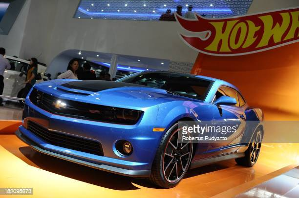 A woman looks into Camaro SS Hot Wheels on display at The 21st Indonesia International Motor Show 2013 on September 28 2013 in Jakarta Indonesia The...