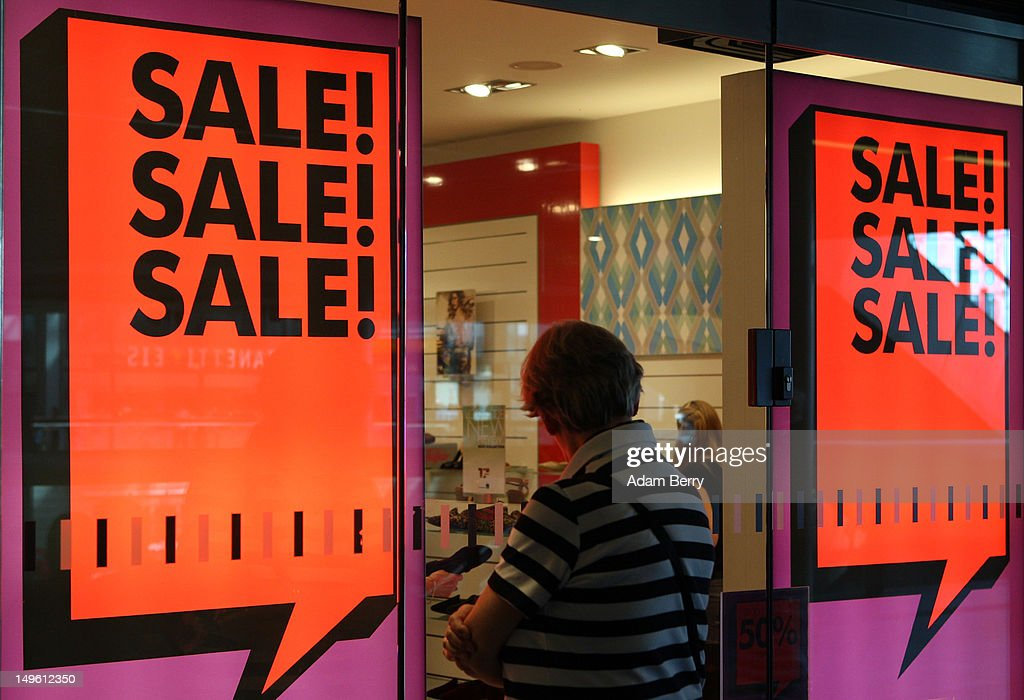 A woman looks into the window of a store advertising summer sales on August 1, 2012 in Berlin, Germany. German retailers began their annual summer clearance sale on Monday, offering deep discounts of up to 80 percent on warm weather items as they prepare to stock up for the autumn shopping season.