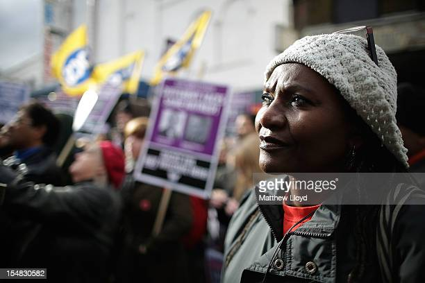 A woman looks on as a demonstrator rallies to protest against the farright English Defence League in Walthamstow on October 27 2012 in London England...