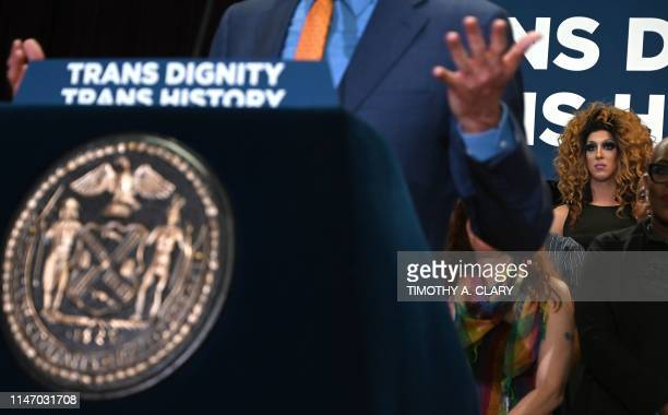 A woman looks on as New York City Mayor Bill de Blasio speaks during an event at the The Lesbian Gay Bisexual Transgender Community Center in New...